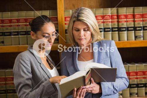Lawyers talking in the law library