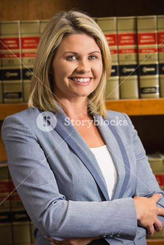 Lawyer smiling at camera in law library