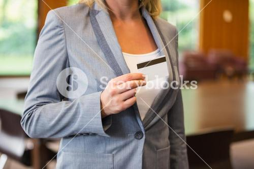 Businesswoman showing a white card