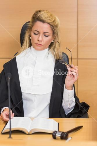Stern judge reading her notes