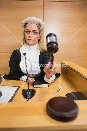 Stern judge banging her hammer
