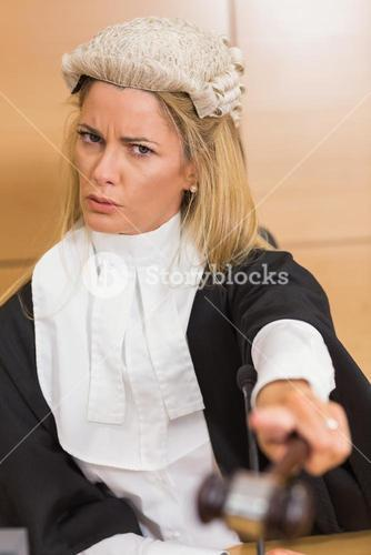 Stern judge pointing her hammer