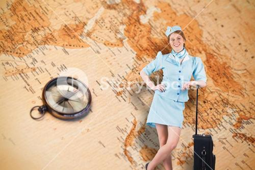 Composite image of pretty air hostess smiling at camera