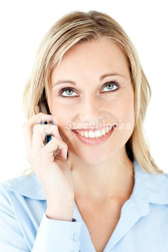 Portrait of a merry businesswoman talking on phone
