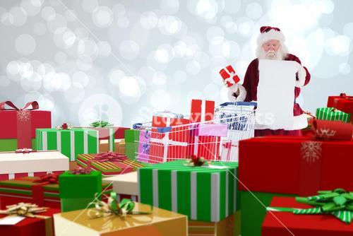 Composite image of santa delivering gifts from cart
