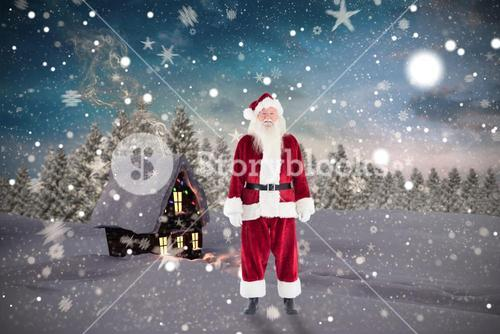 Composite image of jolly santa smiling at camera