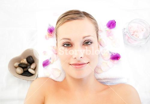 Close up of a cute woman lying on a massage table