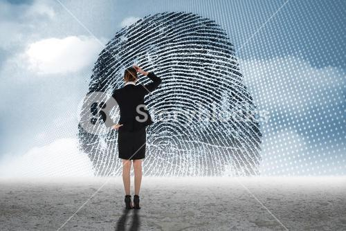 Composite image of young businesswoman standing and thinking