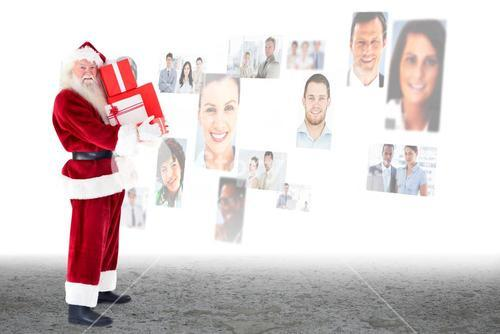 Composite image of santa carrying gifts