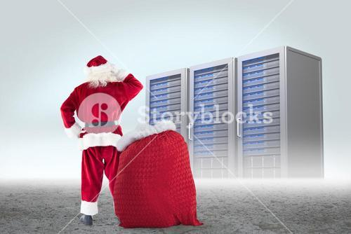 Composite image of santa with sack of gifts