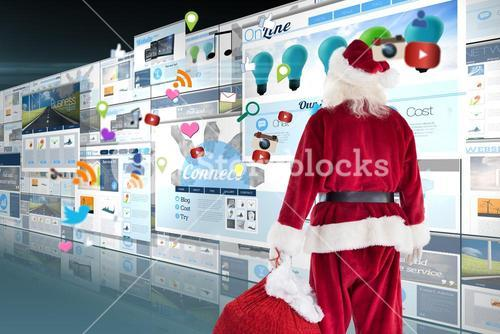 Composite image of santa carrying sack of gifts