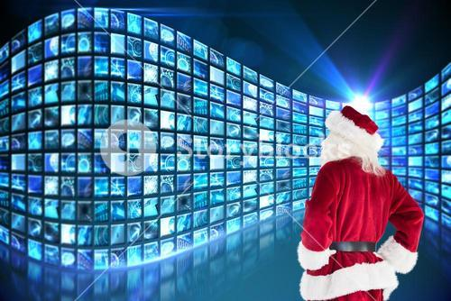 Composite image of santa looks away from the camera
