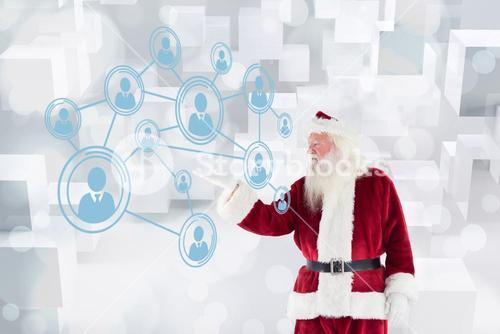 Composite image of santa shows something to camera