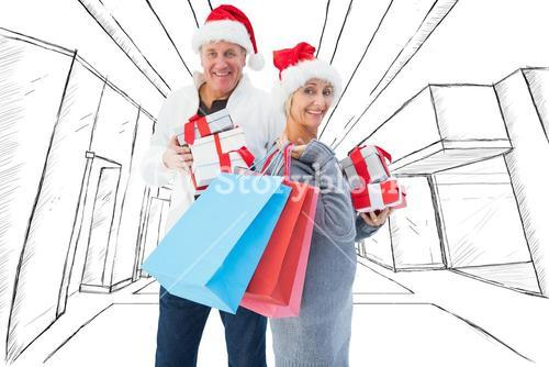 Composite image of couple with shopping bags and gifts