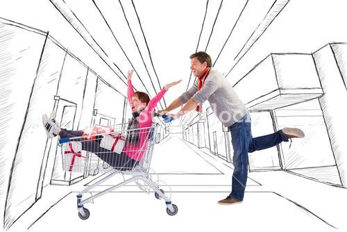 Composite image of man pushing woman in trolley