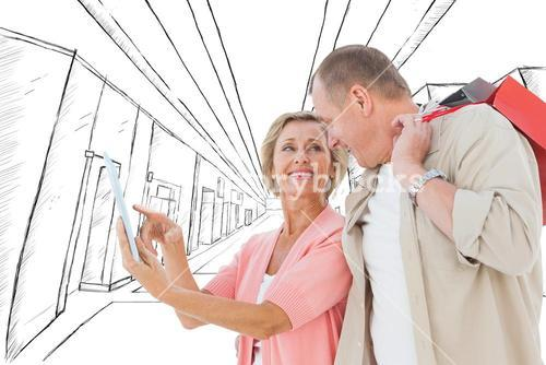 Composite image of couple with shopping bags and tablet