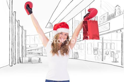 Composite image of festive blonde with boxing gloves and shopping bag