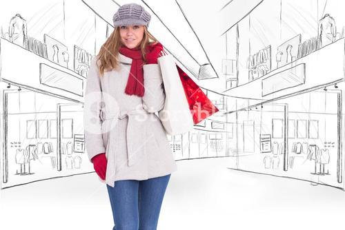 Composite image of happy blonde in winter clothes with bags