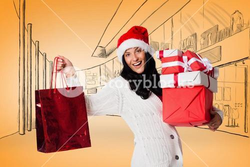 Composite image of smiling woman with christmas presents