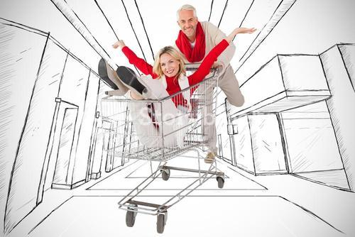 Composite image of happy festive couple messing in trolley