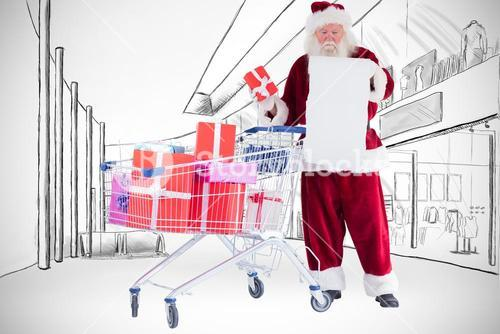 Composite image of santa spread presents with shopping cart