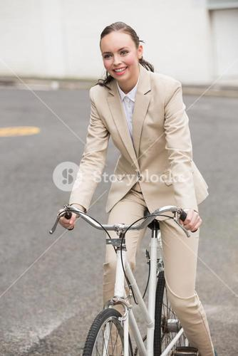 Young businesswoman riding her