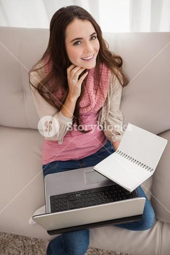 Pretty brunette studying with laptop