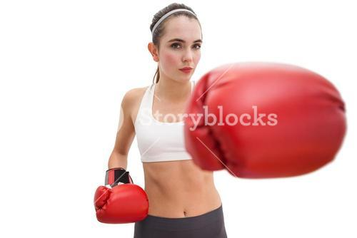 Fit brunette in boxing gloves