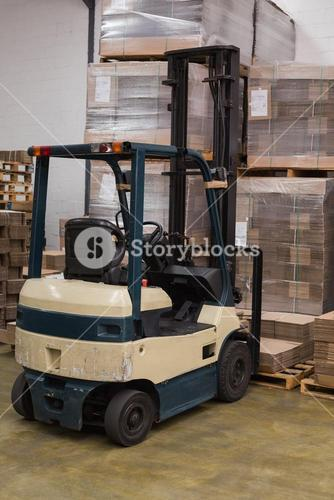 Forklift in a large warehouse