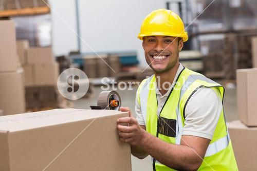 Worker preparing goods for dispatch