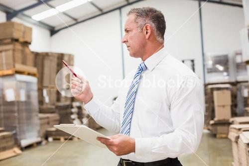 Warehouse boss checking his inventor