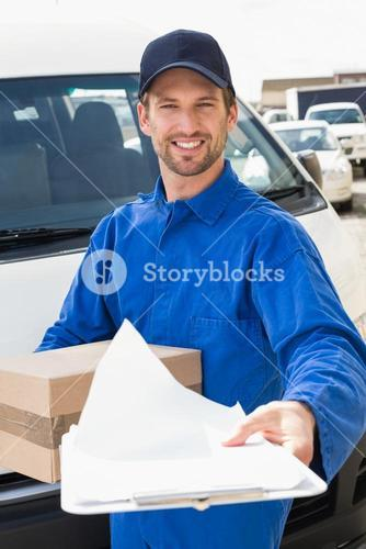 Delivery man showing clipboard to sign to customer