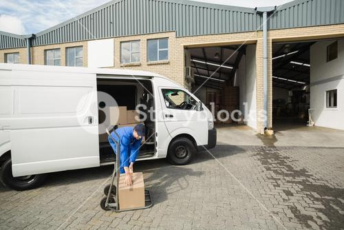 Delivery driver packing his van
