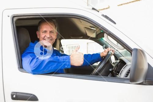 Delivery driver showing thumbs up driving his van