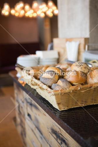 Basket with fresh and delicious roll of bread