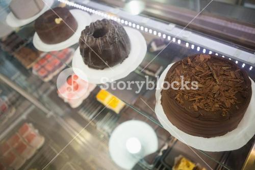 Display case with chocolate cakes