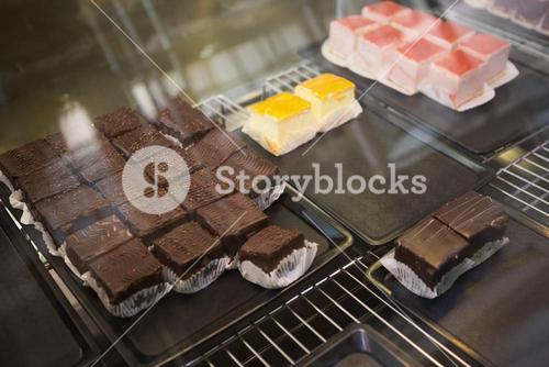 Display case with cheesecakes and brownies