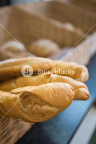 Close up of basket with rustic baguettes
