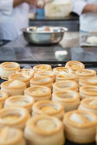 Colleagues making vol-au-vent together
