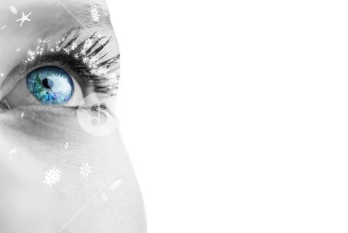 Composite image of close up of female blue eye