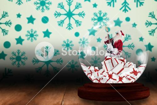 Santa rocking out in snow globe