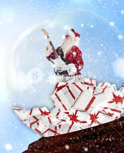 Composite image of santa rocking out in snow globe