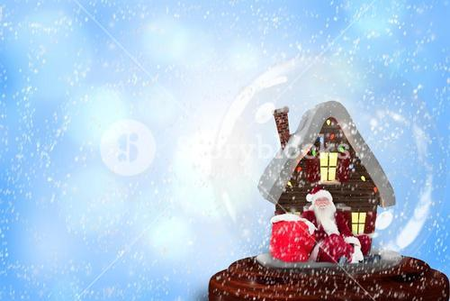 Santa sitting in snow globe