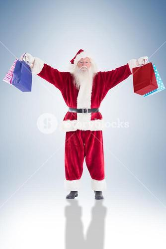 Santa holds some bags for chistmas