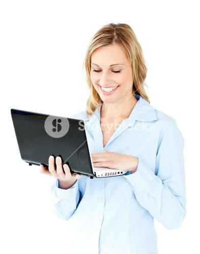 Jolly young businesswoman holding a laptop