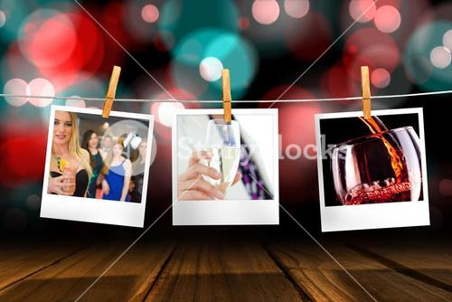 Composite image of businesswoman holding a glass