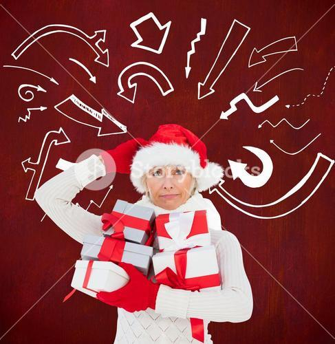 Festive woman in santa hat holding gifts