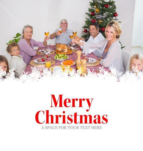 Composite image of family raising their glasses at christmas