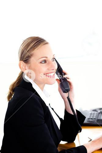 Ambitious businesswoman talking on phone