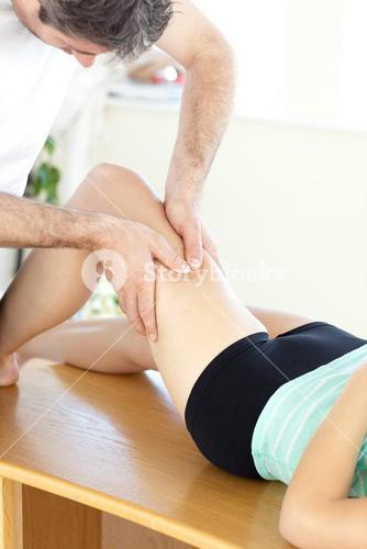 Woman receiving a leg massage in a health club